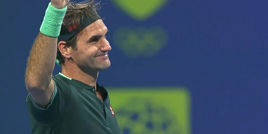 Roger Federer smiles after his first match in over 400 days
